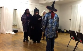 Young performers in witches hats and masks. Film of participation project